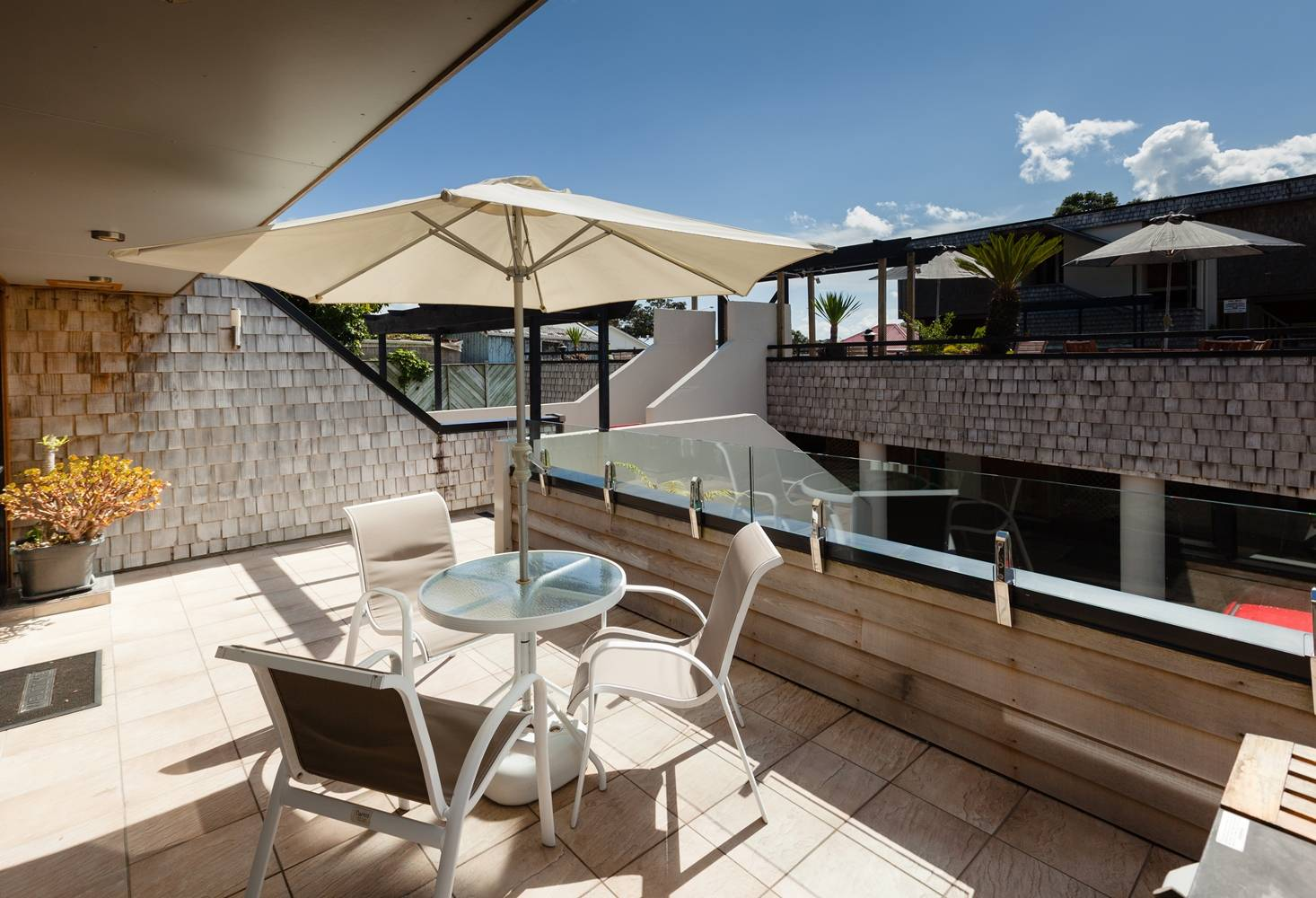 pioneer-apartments-paihia-pool-view-garden-level-deck.jpg